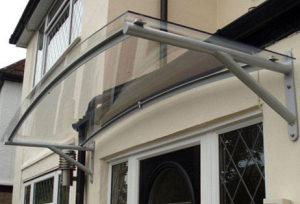 polycarbonate door canopy & HOUSE OF CANOPIES LTD cantilever glass door canopy curved ...